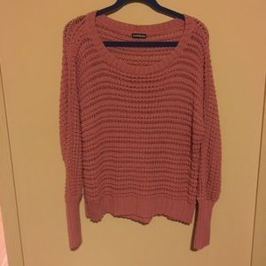 Each pink knit sweater
